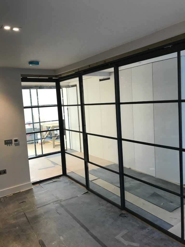 Crittall sliding door and Partition by Design Plus London 2