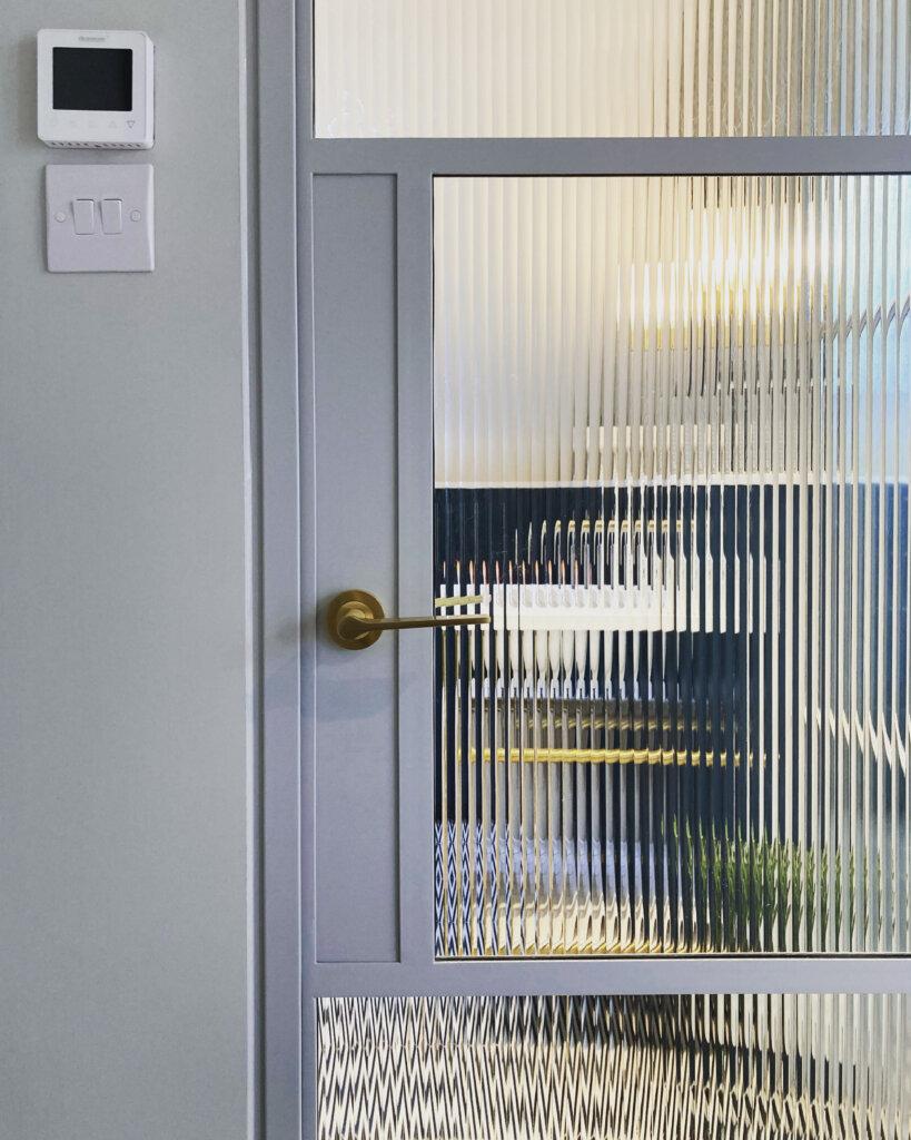 Steel door and fluted glass